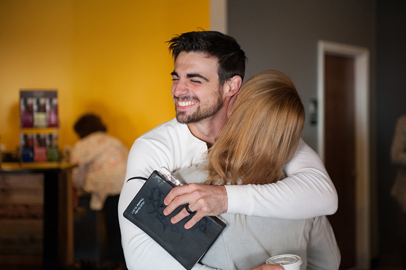 Happy-man-and-woman-hugging
